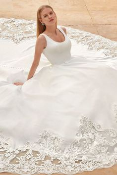 Simplicity meets opulence with this regal Satin, Scoop neck Ball gown. Decadent embroidered lace embellishes the skirt and continues into the magnificent extended Cathedral train. | wedding,satin gown,wedding dress with train,wedding dress,elegant wedding dress,ballgown wedding dress,wedding gown,elegant wedding dress,chic wedding dress,elopement wedding, elopement wedding dress,micro wedding,micro wedding dress,bridal style,summer wedding,wedding planning,wedding inspo,small backyard… Chic Wedding Dresses, Wedding Dress Train, Elegant Wedding Dress, Country Wedding Dresses, Designer Wedding Dresses, Wedding Dress Styles, Bridal Dresses, Wedding Gowns, Lace Wedding