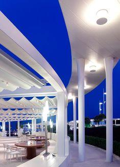 Meandering concrete roof shelters walkways at Erginoğlu & Çalışlar's renovated beach club.