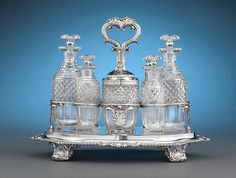 This beautiful 9-piece cruet was masterfully crafted by the legendary Paul Storr, Hallmarked London, 1802 ~ M.S. Rau Antiques