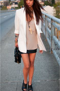 Very cool black and white look  Lady-like purse and blazer  But paired with bad-ass leather skirt, shoes, and punk jewelry