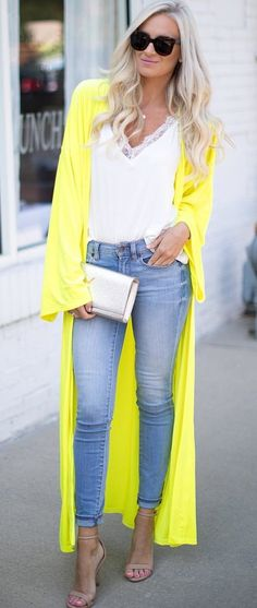 #fall #outfits women's yellow cardigan. white plunging neckline lace floral blouse and blue denim high-waist jeans