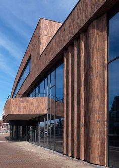 Волнистые кирпичные фасады »Bouwwereld.nl