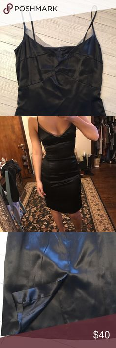 Kenneth Cole Satin Midi Read carefully!  This simply stunning dress is the LBD staple you need in your closet! Weddings, cocktail, date night, this dress will take you far!  100% acetate, satin look.  Mesh detail at bust, so delicate and subtly sexy.  Dress up even more with jewelry and shoes!  Worn once for a wedding.  Maybe an undetectable snag, can't even get a picture.  Dry clean only.  NOW, this dress was a size 8, I had taken in to about a size 0-2.  It no longer zips up on me and I am…