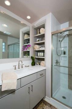 Recessed shelves next to basin for extra storage