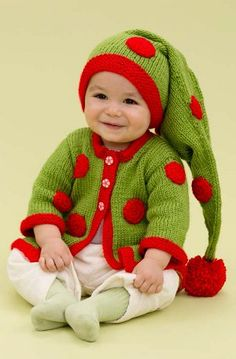 Santa's Baby Elf | AllFreeKnitting.com Cute baby outfits for Christmas are an absolute must for this holiday season. Dress your little one up in this Santa's Baby Elf ensemble.