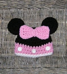 Cute Minnie mouse hat, crocheted using 100% quality acrylic yarn, its soft, warm and comfortable, ideal to protect babys delicate skin. Crochet buttons and bow are securely attached. Perfect for baby shower gift, Disney trip or photo prop.