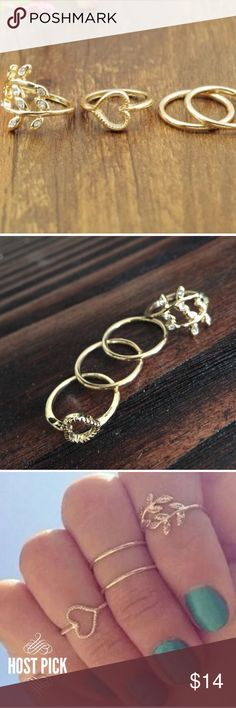 Set of 4 Gold Midi Rings Set of 4 Gold Midi Rings. The heart and leaf ring are size 4 1/2 and the other two are size 5 1/2. Great addition to mix and match with other rings. Jewelry Rings