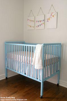 simple, pretty nursery. with a yellow or green cot this could be a unisex nursery