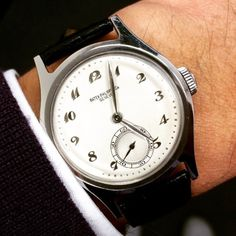 """""""Sometimes it's just perfect. The 1945 Patek Philippe 565 in steel with Breguet numerals. Photo via @johnbehalf. #patekphilippe"""""""