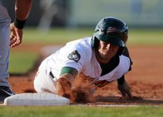 Boise Hawks' David Bote dives back to first base during a game against the Tri-City Dust Devils Friday, June 13, 2014 at Memorial Stadium in Boise.