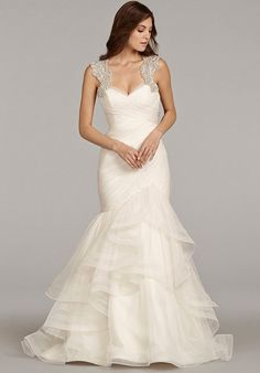 Ivory English net fit to flare bridal gown with ruched detailing on bodice, double horsehair trim flounced skirt, alabaster and crystal encrusted keyhole back with chapel train.