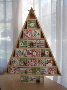 cute but I would make it without the triangle frame, just the stacked blocks/drawers - kid project someday