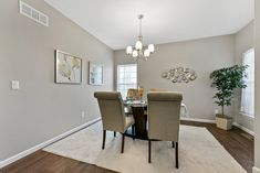 This new construction ranch-style home in Columbia, IL is perfect for young couples or empty-nesters. Home Staging Companies, Young Couples, Ranch Style, New Construction, Be Perfect, St Louis, Empty, Columbia, Dining Table