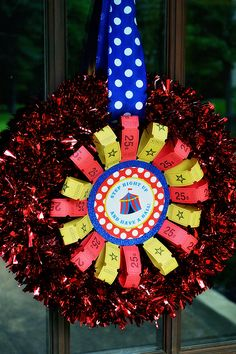 Amazing circus theme birthday party! - Welcome wreath made using Chickabug printables and carnival tickets