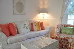 Jane Coslick Cottages-love the coral pillows