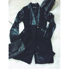 Qian Mei Faux Leather Black Trench Coat This coat is gorgeous. The faux leather is soft to the touch and the cut is structured and flattering without being stiff. The sizing is (due to the brand) is misleading as this would fit a small more accurately. Beautiful detailing and great condition! Qian Mei Jackets & Coats Trench Coats
