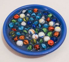 These hand-crafted 6-inch decorative dishes are made with marbles.  hand paint both sides, deep blue on the bottom and a light blue inside. Creative Ceramic Soap Dishes by Timeout4me on Etsy, $12.00