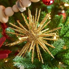 This eye-catching ornament will be the focal point of your decorations! Insert a wooden skewer into a plastic-foam ball to use as a handle while painting. Paint the ball with gold acrylic paint. Place the skewer in a cup; let dry. Insert 50 toothpicks in the ball, spaced evenly. Brush with crafts glue, being sure to cover ball and sides of toothpicks. Sprinkle glitter onto wet glue, working over a surface that allows you to gather the glitter. Let dry and remove the skewer.