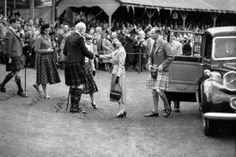 Queen Elizabeth ll and the Duke of Edinburgh are greeted on their arrival at the Braemar Highland Games in September, 1954