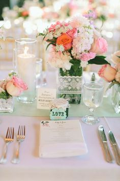 Lovely tablescape. I would probably choose different flowers for the bouquet and have the base tablecloth be peachier!