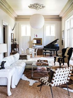 Gorgeous black, white and neutral brown living room with a mix of traditional French-inspired furnishings and modern, sculptural accents.