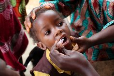 Child receiving polio vaccination in Liberia Photo by The Times/Ben Gurr
