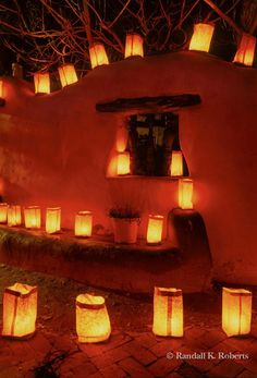 Luminarias on wall, Christmas Eve, Old Town Albuquerque, New Mexico