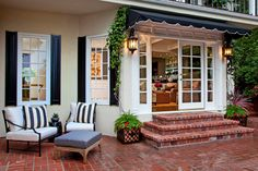 Shocking-Front-Door-Awning-Ideas-for-Patio-Transitional-design-ideas-with-Shocking-awning-black-shutters.jpg 990×660 pixels