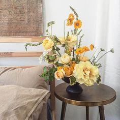 Yellow floral arrangement of tree peony and garden roses by Putnam and Putnam