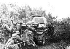 Grenadiers under the cover of a Pz.Kpfw.35 tank belonging to 6.Armored Division engage the defenders of Leningrad, September 1941.