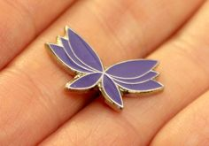 Purchase one of our purple butterfly pin badges to show your support! £1.50 in our shop now