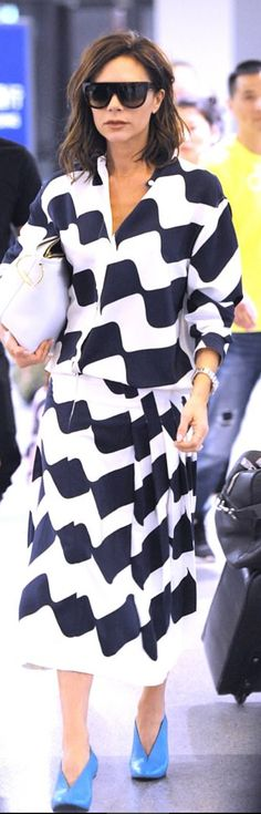 Who made Victoria Beckham's pleat skirt, white handbag, white wave top, and sunglasses?