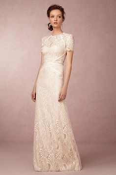 I love this sleek, modern dress with the sheer geometers. Would be awesome for a city shoot. Beilin Gown