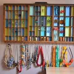 Display the beauty of both your jewelry and a vintage printers tray!