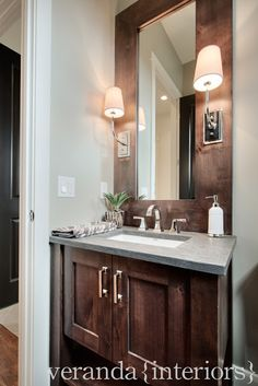 gorgeous bathroom design Clever way to install sconces. DIY Ceramic tile that looks like wood.perfect for a kitchen, bathroom, or baseme. Dark Wood Bathroom, Modern Bathroom, Veranda Interiors, Home Inc, Upstairs Bathrooms, Bathroom Inspiration, Bathroom Ideas, Bathroom Rules, Custom Home Builders