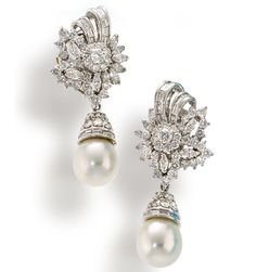 A pair of diamond and South Sea cultured pearl day/night earrings, circa 1950  each designed as a floral cluster of marquise and round brilliant-cut diamonds accentuated by baguette-cut diamond scrolls, suspending a detachable drop-shaped cultured pearl, pavé-set and baguette-cut diamond pendant; estimated total diamond weight: 8.85 carats; mounted in platinum; length: 1 7/8in.