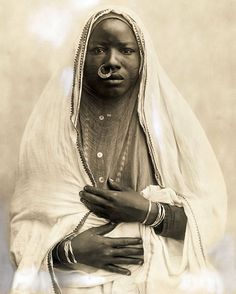 """""""Egyptian types and scenes. - Soudanese woman"""". Portrait of a Sudanese woman from Egypt in traditional clothes, date 1920 or earlier."""