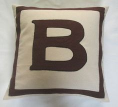 Coveting these cream and brown monogram initial pillows. Definitely going to add this to our bedroom makeover!