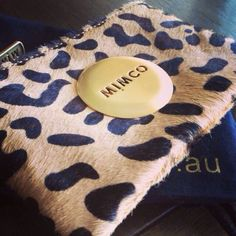 I dont go anywhere without my Mimco purse- it just fits everything in!!