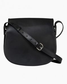 The Salli Lea saddle bag is made of black leather. The bag has an adjustable shoulder strap, a front flap with magnetic button closure and a frontal pocket underneath the flap. There is one zipper pocket on the inside. Marimekko Bag, Beautiful Handbags, Black Leather Bags, Italian Leather, Cosmetic Bag, Saddle Bags, Bag Accessories, Shopping Bag, Shoulder Strap