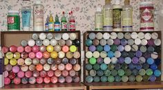 Store craft paints bottom out so the color is visible. These are two cardboard boxes cut to the depth of the paint bottle. Efficient on shelves