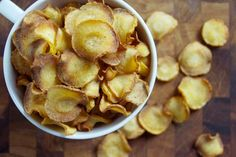 Baked Parsnip Chips are a yummy and addictive seasonal snack. You'll keep coming back for more!
