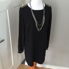 Fancy Black Cocktail Dress- NWT Embellished shoulders, sheer long sleeves, and zip up back. Great dress for a formal or fancy event ! Never been worn! Forever 21 Dresses Midi