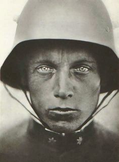 "Austrian-Hungarian soldier, 1918. ""It looks like a thousand yard stare, it's like there's nothing there. The rank insignia indicates that he is Austrian-Hungarian soldier, not German, he's a lance corporal. In case you're wondering, those lugs on the side of his Stahlhelm helmet were combination air vents and mounting lugs for an extra armor plate for nervous soldiers.""  More information about the Stahlhelm helmet at link."