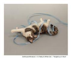 Miniature cat sculpture by Kerri Pajutee