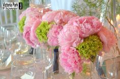 Bridesmaids Bouquets composed of Pink Peonies and Green Hydrangea recycled into gorgeous centerpieces