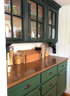 copper countertop, glass front cabinets