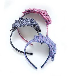 SILK TIE HEADBAND    Our favorite new accessory, a silk print headband with oversized bow.