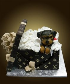 ~ Puppy in a Louis Vuitton gift box ~  Fondant puppy, about 5 inches, with fondant lid, loop bow and ribbons, the cake portion is the gift box. Hand painted gold detail.