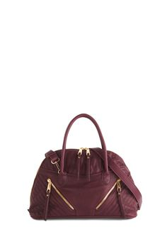 Got It in the Bag. Leaving your interview, your confidence radiates as you swing this cabernet-hued bag by Melie Bianco! #purple #modcloth